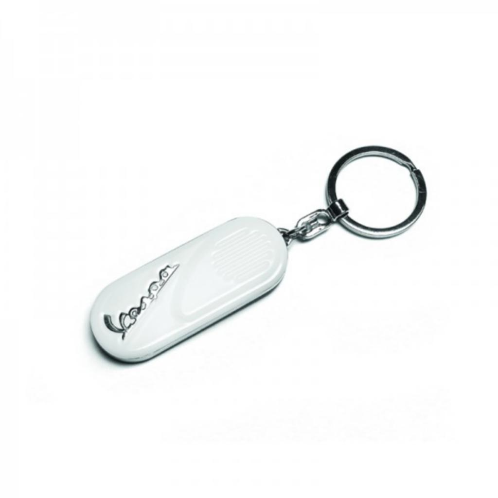 Chromed key ring with a red background